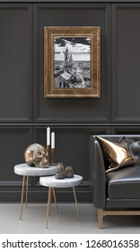 Luxury interior of a black and metallic gold living room with black and white pictures, copper skull, side tables, sofa, cushions and ethnic sculptures.  3D rendering illustration