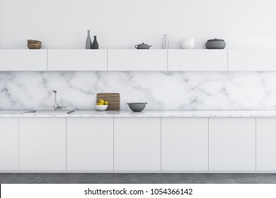 Luxury kitchen interior with white marble walls, a concrete floor, and white countertops. 3d rendering mock up