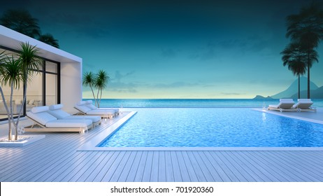 Luxury modern style at the exterior beach houses with a private swimming pool,beach lounge at evening,summer paradise ,Lounge of the breathtaking view sea and sky/3d rendering