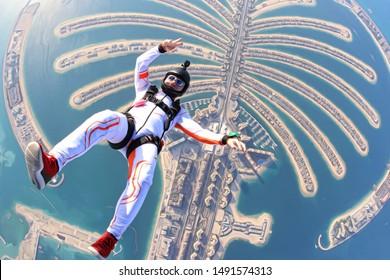 Luxury travel rest. Tourism Sky diving fun crazy men rest on UAE Dubai sea palm in free fall. Goal skydive Dubai. Summer fun crazy jump.