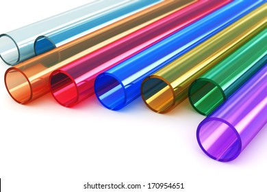 Macro view of set of color transparent acrylic plastic tubes isolated on white background with selective focus effect