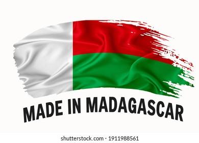 Made in Madagascar handwritten vintage ribbon flag, brush stroke, typography lettering logo label banner on white background.