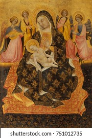 MADONNA AND CHILD WITH ANGELS, by Pietro di Domenico da Montepulciano, 1420, Italian Renaissance painting. This stylistically conservative work employs flat medieval decorative elements. The Madonna i