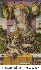 MADONNA AND CHILD, by Carlo Crivelli, 1480, Italian Renaissance painting, tempera, oil on wood. Crivelli painted this with Trompe-l\x90oeil details. The apples and fly are symbols of sin and evil