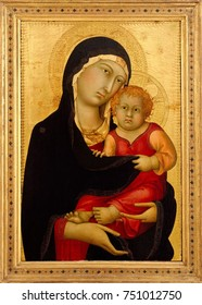 MADONNA AND CHILD, by Simone Martini, 1326, Italian Proto-Renaissance painting, tempera on wood. Simone Martini, a leading Sienese painter, created this as part of a multi-paneled altarpiece. It still
