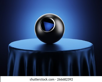 Magic 8 Ball on table in blue studio