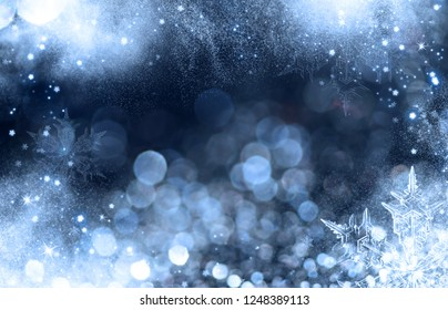 Magic holiday glitter background with blinking stars and ice. Blurred bokeh of Christmas lights.