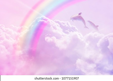 magic rainbow fantasy cloud background  fluffy sky white landscape with sunny rays. Pastel colors sleep dreams 	 slumber dolphins realistic photo collage concept