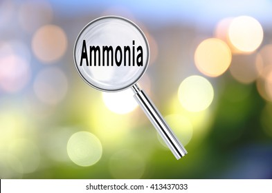Magnifying lens over background with text Ammonia, with the blurred lights visible in the background. 3D rendering.