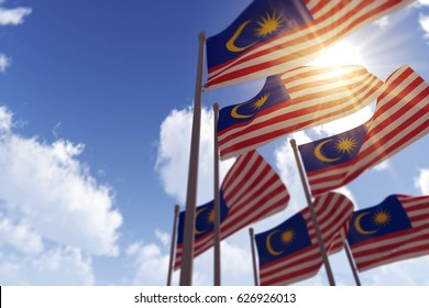 Malaysia flags waving in the wind against a blue sky. 3D Rendering