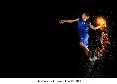 Male basketball player jumping and practicing with a ball