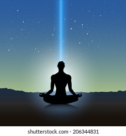 Male silhouette in meditation pose on landscape