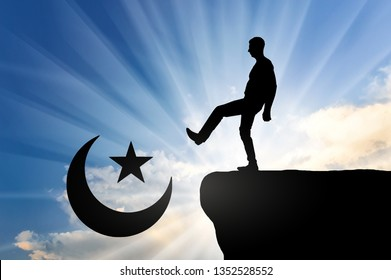 Man atheist pushes symbol of islam into cliff. Concept of atheism