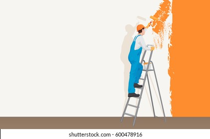 Man decorator painter painting a color wall. Process concept.