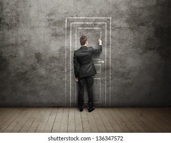 Man drawing door