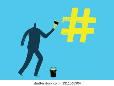 Man draws hash tag with yellow paint using brush, Illustration, making hash tags concept, creating, placing, hash tags