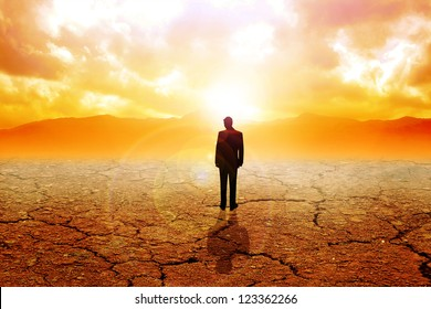 A man figure standing on dry land