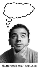 A man with his hand on his chin thinks deeply about something. Blank thought bubble above for your text or image.