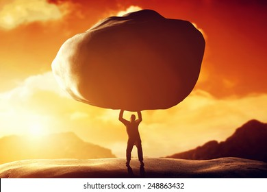 Man lifting a huge rock. Metaphor, concept of strength, burden, ballast, power etc.