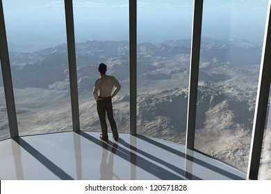 man looks at the mountain from a height