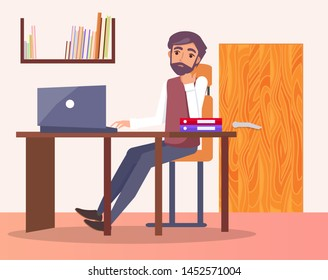 Man in office at workplace typing on computer, bookshelf and door behind him, male sitting at table on chair, entrepreneur worker, folders on desk