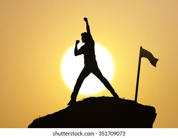Man on the peak of mountain ,success,winner,team work concept