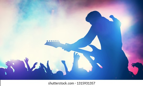 Man performing on music concert. Cheering crowd, fans, entertainment. Music industry. 3D illustration.
