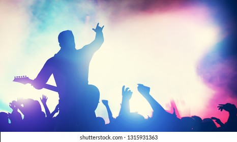 Man playing guitar at the stage, crowd cheering. Concert, music gig. Audience, fans, fame, entertainment. 3D illustration.