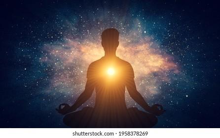 Man and soul. Yoga lotus pose meditation on nebula galaxy background. Zen, spiritual well-being. 3D illustration
