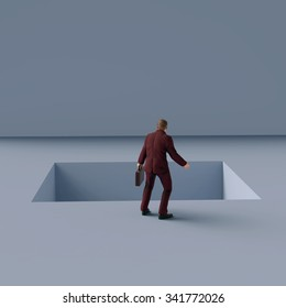 man standing on the edge of pitfall