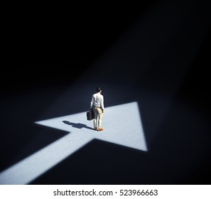 Man standing in a spotlight forming an arrow symbol - 3d illustration