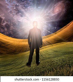 Man stands in green field. Shining light comes from his head. 3D rendering
