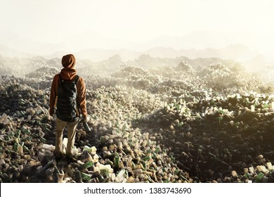 Man stands on top of plastic waste mountains