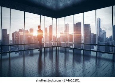 Man in suit looking at the city and sunset. 3d rendering
