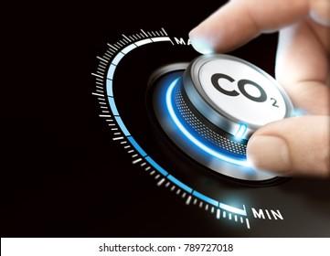 Man dreht einen Kohlendioxidknopf, um die Emissionen zu reduzieren. Konzept der CO2-Reduktion oder -Entfernung. Zusammenspiel von Bild zwischen Handfotografie und 3D-Hintergrund.