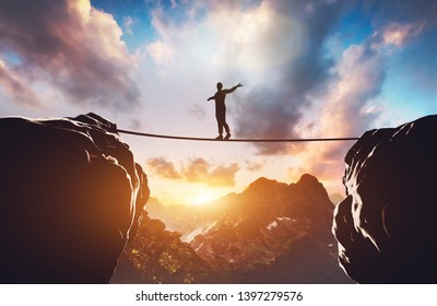 Man walking on rope between two high mountains at sunset. Concept of taking a risk, adventure, motivation. 3d illustration