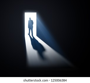 A man walking out through open doors