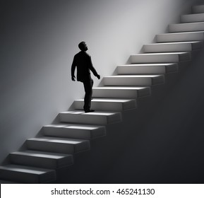 Man walking up the stairs towards light - 3d illustration