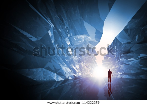 Man walks through the fantasy crystal corridor with rugged walls and bright glowing end
