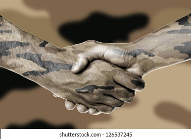 Man and woman shaking hands, camouflaged