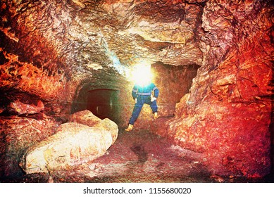 Man worker check something in abandoned mine tunnel. Underground job.   Hipster filter.