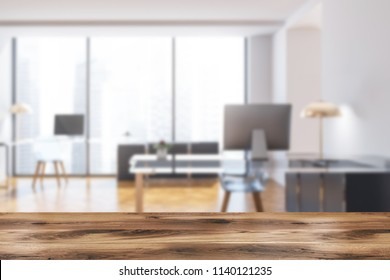 Manager office interior with dark gray walls, panoramic windows, a wooden floor and a stylish computer table. Front view 3d rendering mock up blurred