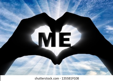 Man's hands hold the word to me, showing that he likes this as a symbol of the heart. Concept of selfishness and narcissism