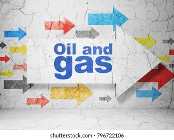 Manufacuring concept:  arrow with Oil and Gas on grunge textured concrete wall background, 3D rendering