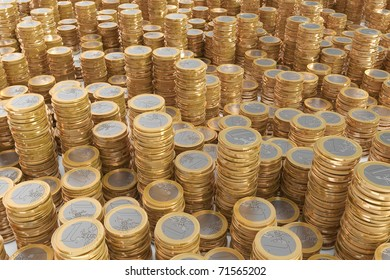 Many piles of one Euro coins