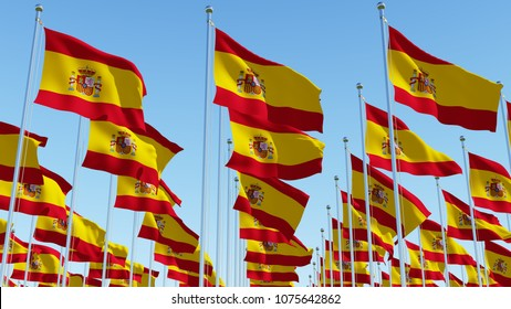 Many Spain flags in rows waving against clear blue sky in sunny day. Three dimensional rendering 3D illustration.