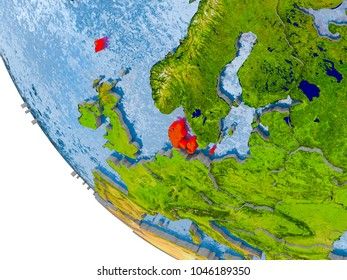 Map of Denmark in red on globe with real planet surface, embossed countries with visible country borders and water in the oceans. 3D illustration. Elements of this image furnished by NASA.