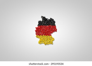 Map and flag of Germany made out of pills on white background