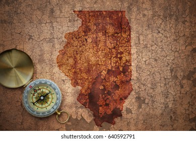 map of illinois state on a old vintage crack paper background with compass