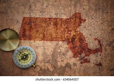 map of massachusetts state on a old vintage crack paper background with compass